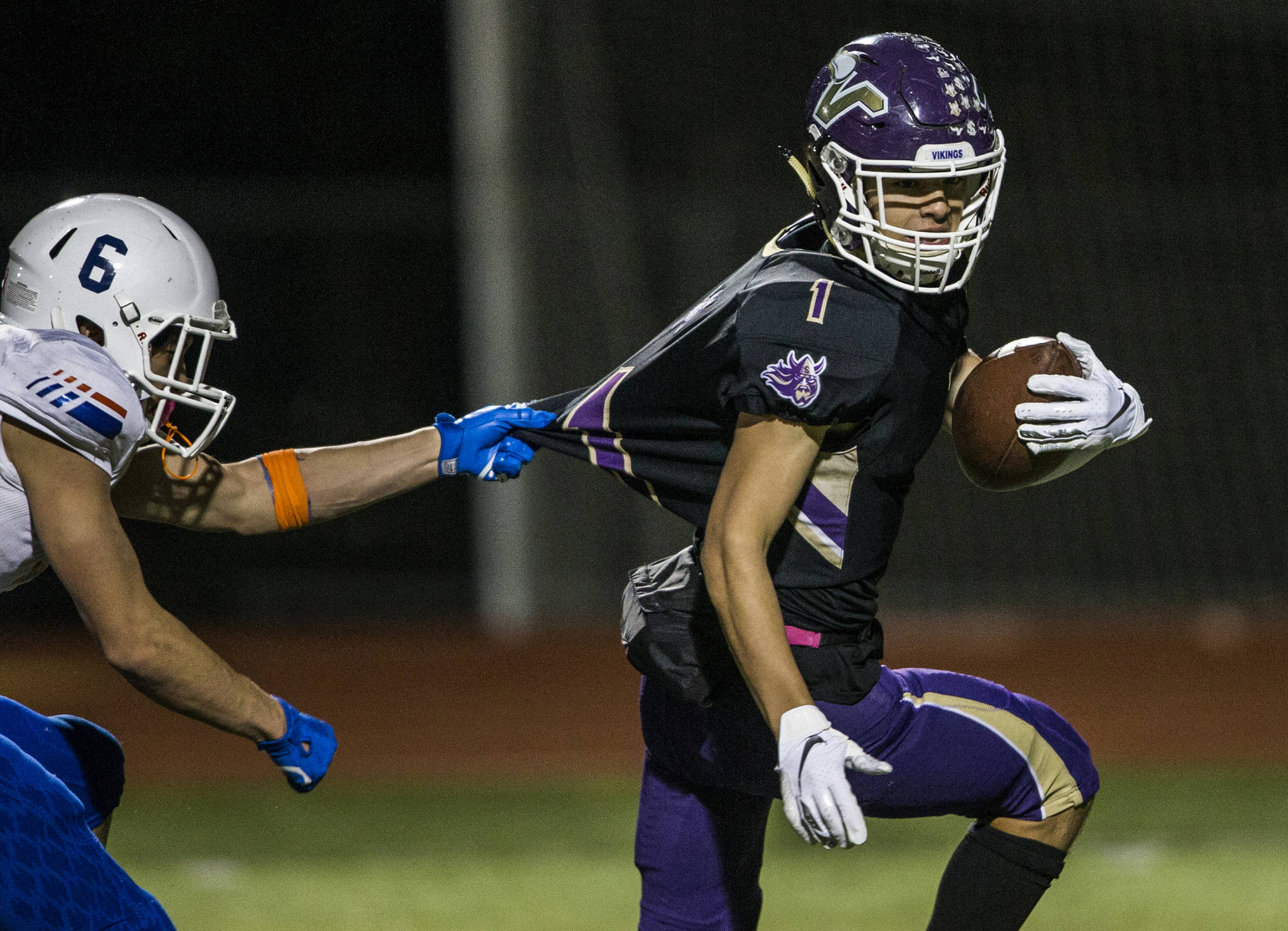 Lake Stevens' Ian Hanson runs the ball into the end zone while his jersey is pulled during the game against Graham Kapowsin on Saturday, Nov. 17, 2018 in Everett, Wa. (Olivia Vanni / The Herald)