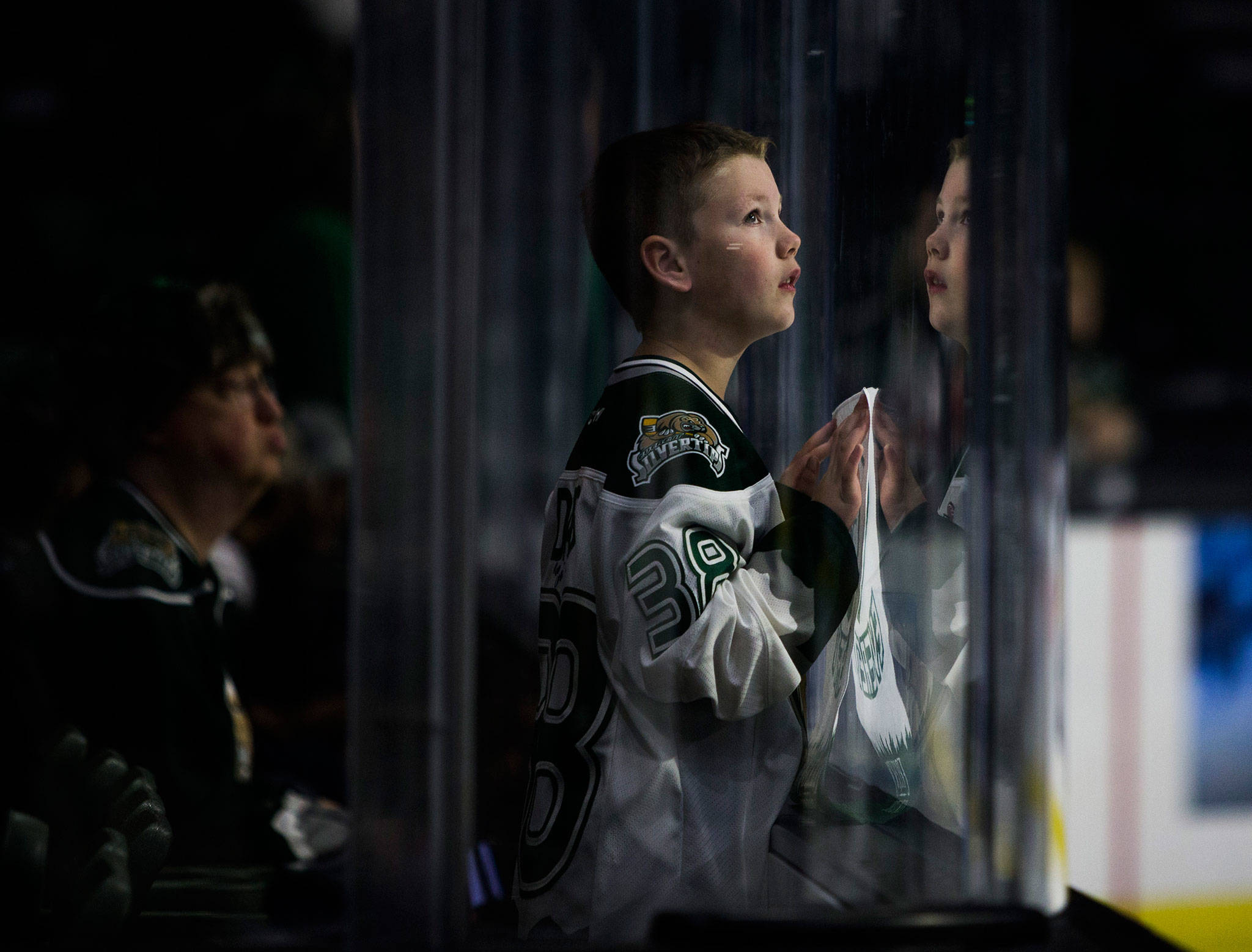 A young Silvertips' fan looks up at the jumbotron before the game against the Spokane Chiefs on Sunday, Nov. 18, 2018 in Everett, Wa. (Olivia Vanni / The Herald)
