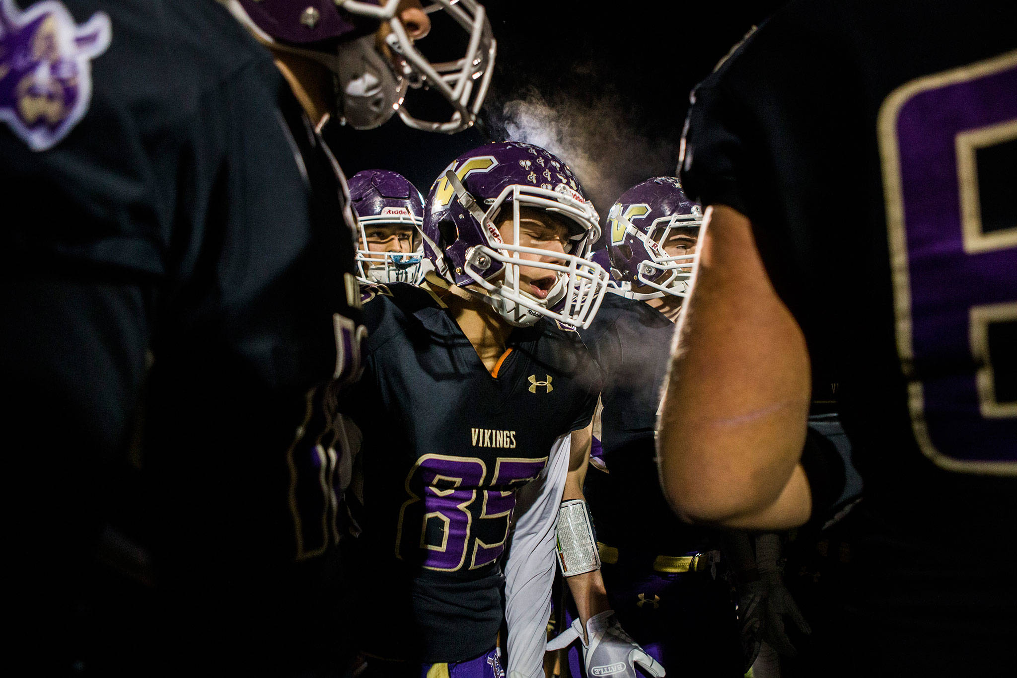"Lake Stevens' Ty Hilton yells in the huddle before the game against Graham Kapowsin on Nov. 17 in Everett. Photo gallery <a href=""https://www.heraldnet.com/sports/gallery-lake-stevens-beats-graham-kapowsin-in-state-quarterfinal/"" target=""_blank"">here</a>. (Olivia Vanni / The Herald)"