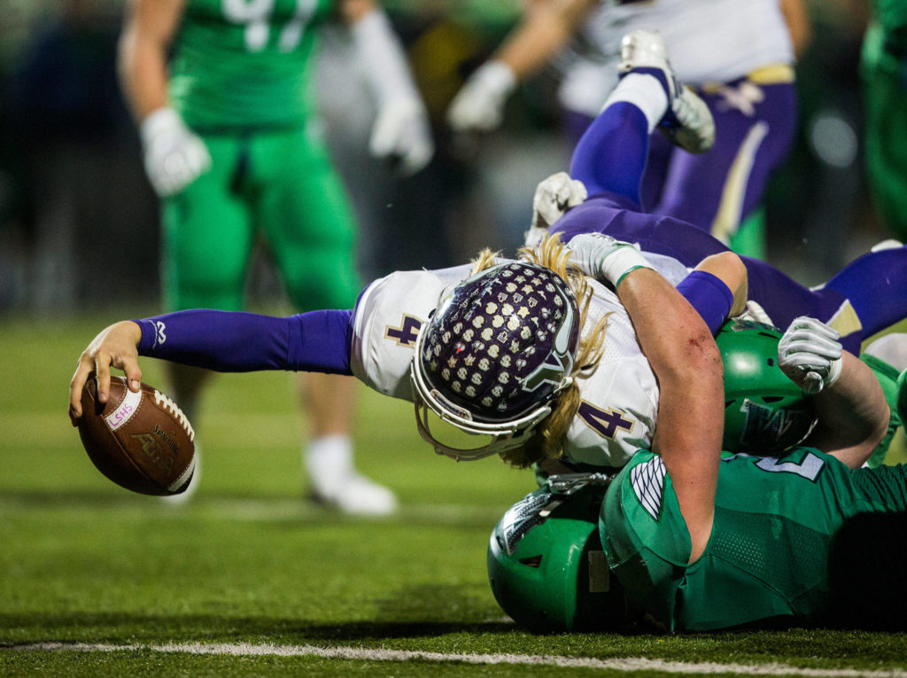 Lake Stevens' Tre Long reaches across the goal line for a touchdown during the Class 4A state state semifinal game against Woodinville at Pop Keeney Stadium on Saturday, Nov. 24, 2018 in Bothell, Wa. (Olivia Vanni / The Herald)