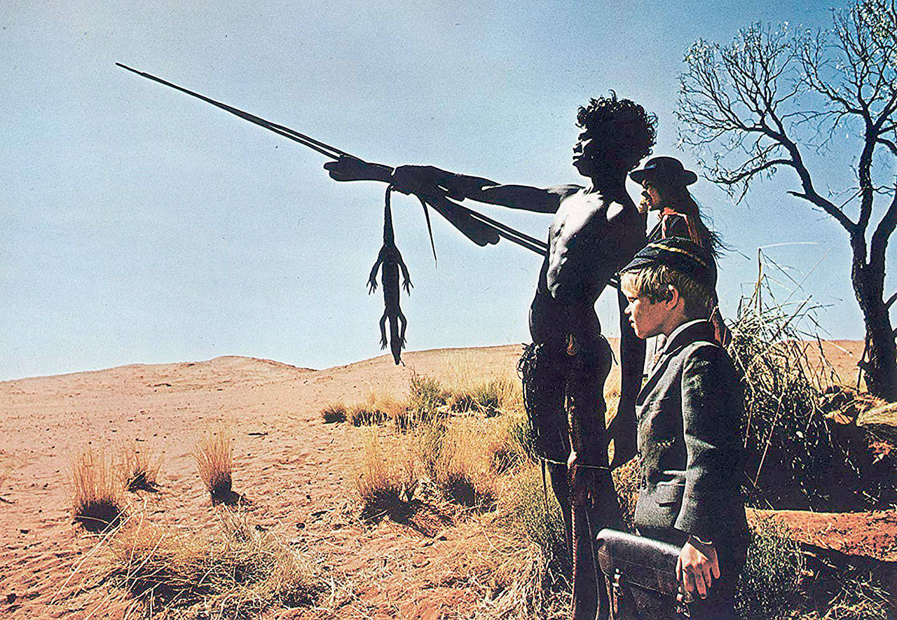 """An indigenous Australian boy (David Gulpilil) takes stranded siblings Jenny Agutter and Luc Roeg (the director's son) under his wing in Nicolas Roeg's 1971 film """"Walkabout."""" (Twentieth Century Fox)"""