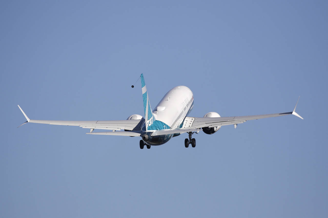 A Boeing 737 MAX 7 takes off on its first flight March 16. (Associated Press file)