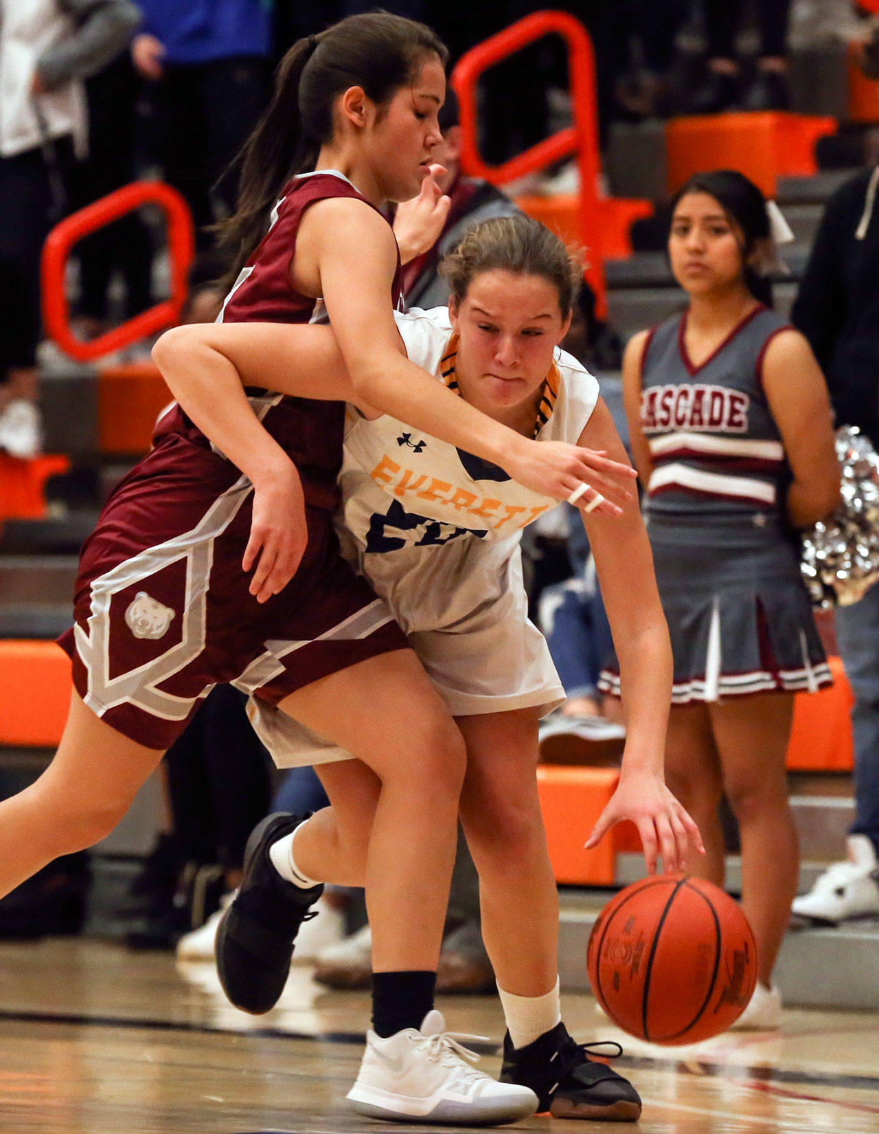Cascade's Yaritza Pelayo (left) fouls Everett's Ella Sylvester during the second quarter of the annual BruGull Fest game Friday at the Walt Price Student Fitness Center at Everett Community College. Sylvester and the Seagulls won the cross-town rivalry clash 51-13. (Kevin Clark / The Herald)