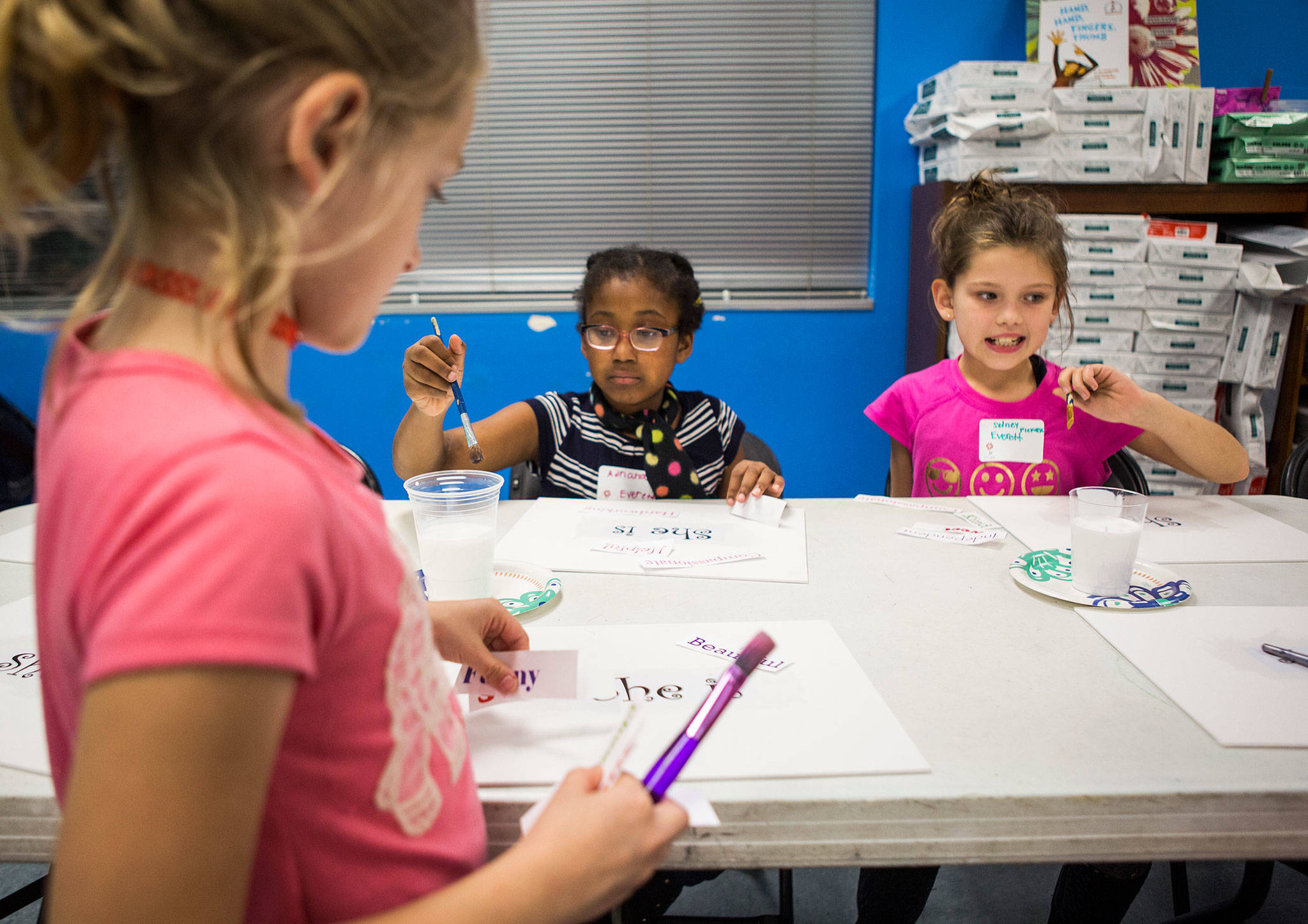 Adriana Smith (center) and Sydney Piekarski (right), both 8, work during an InspireHER event at the Snohomish Boys & Girls Club. (Olivia Vanni / The Herald)