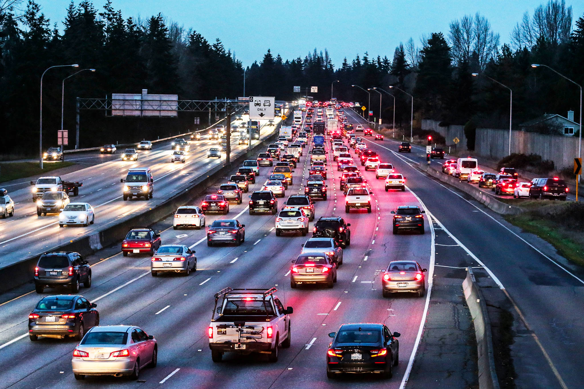 Traffic backing on I-5 at the 145th Street exit in Seattle is part of Michelle Bernath's 18-mile commute to and from Mukilteo, which sometimes takes one hour each way five days a week. (Kevin Clark / The Herald)