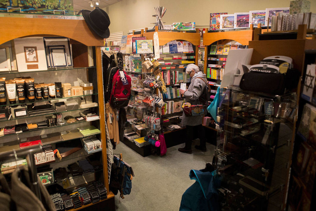 People shop at J. Matheson Gifts, Kitchen Gourmet in Everett. (Olivia Vanni / The Herald)