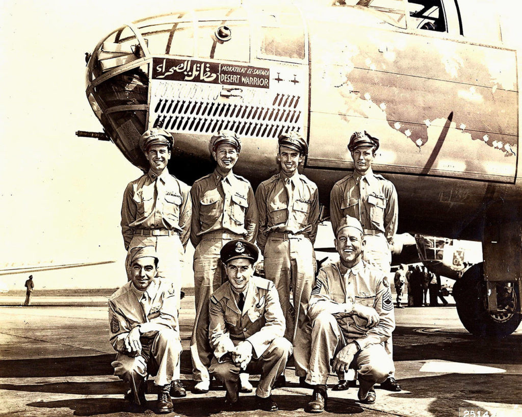 """Everett's Ralph Lower (back row, far left) is shown with the """"Desert Warrior"""" Mitchell B-25 bomber he piloted in North Africa during World War II as part of the U.S. Army 9th Air Force. After flying 52 missions, Lower toured the United States in the plane to promote the sale of war bonds. He died Nov. 24 at age 99. (Photo Courtesy of the Raguso family)"""