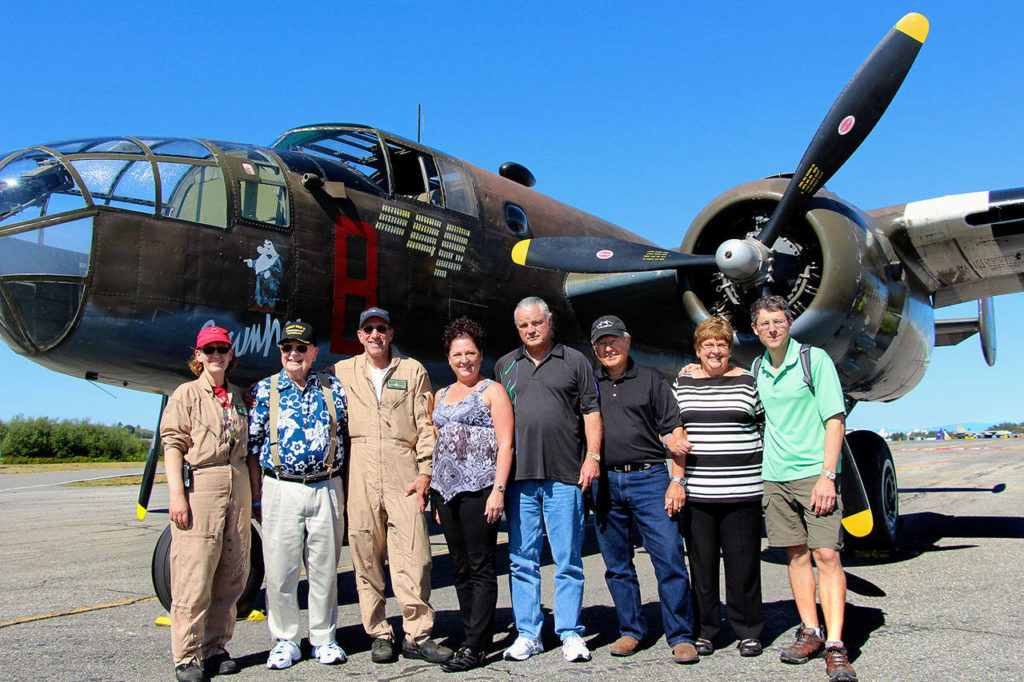 """World War II flier Ralph Lower and his family (he's second from left) took a ride a few years ago aboard """"Grumpy,"""" a restored B-25 Mitchell bomber that's part of the Historic Flight Foundation collection at Paine Field. Lower, who died Nov. 24, flew 52 missions on a B-25 between July 1942 and September 1943. (Courtesy Rod and Sandra Raguso)"""