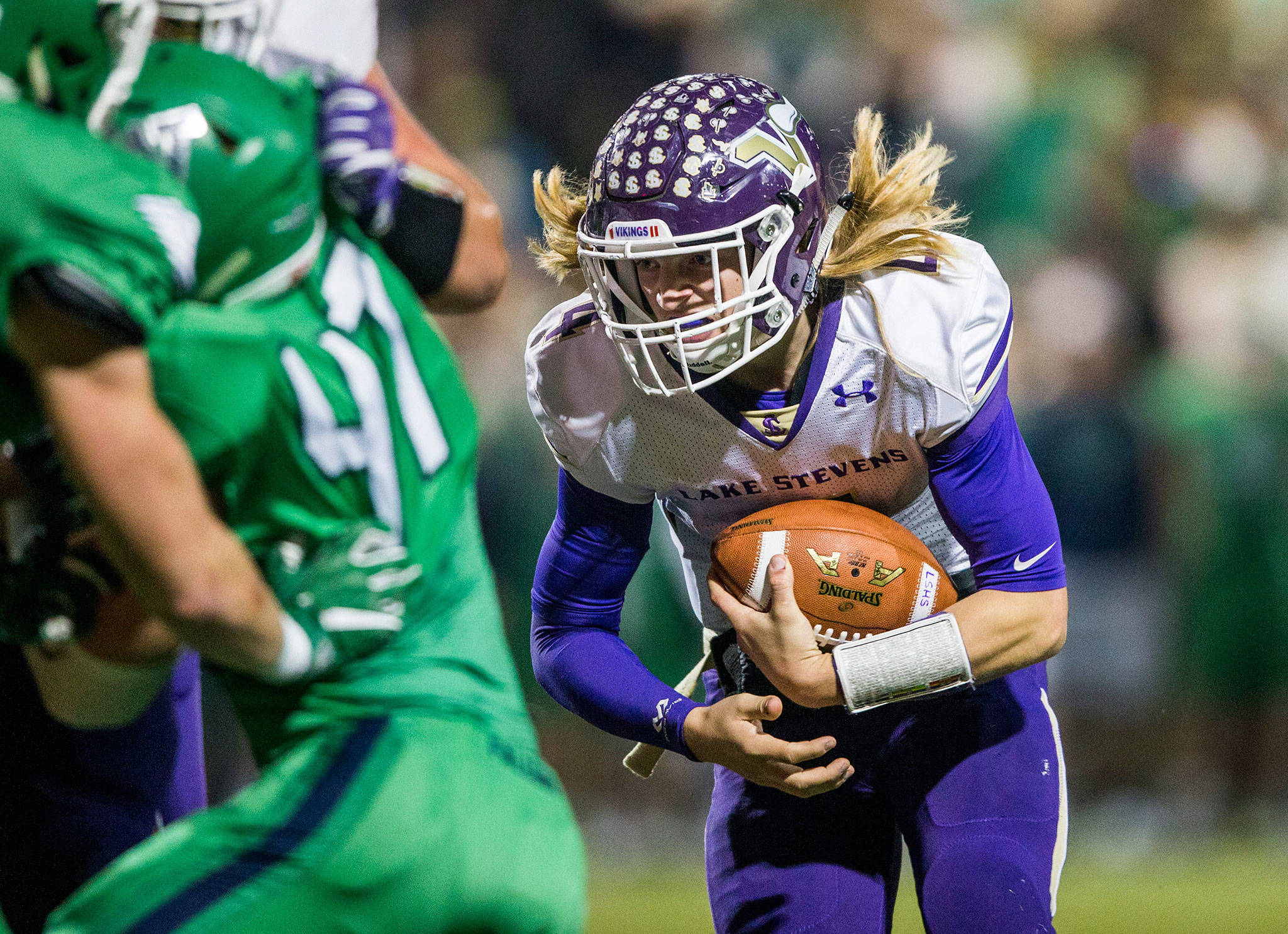Lake Stevens' Tre Long runs the ball during the Class 4A state state semifinal game against Woodinville at Pop Keeney Stadium on Nov. 24 in Bothell. (Olivia Vanni / The Herald)