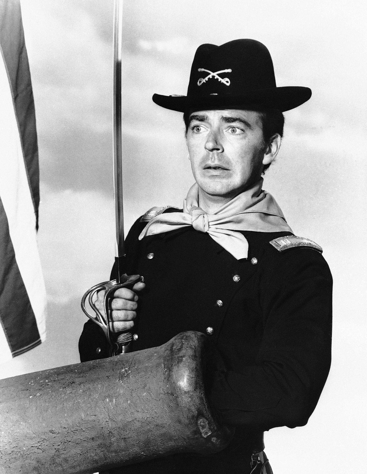 "Ken Berry, who played Captain Wilton Parmenter in a TV series called ""F Troop,"" reaches down the wrong end of cannon in one of the show's episodes in this July 1, 1965, photo. A spokeswoman at Providence St. Joseph in Burbank, California, confirmed Berry died Saturday. He was 85. (AP Photo, File)"