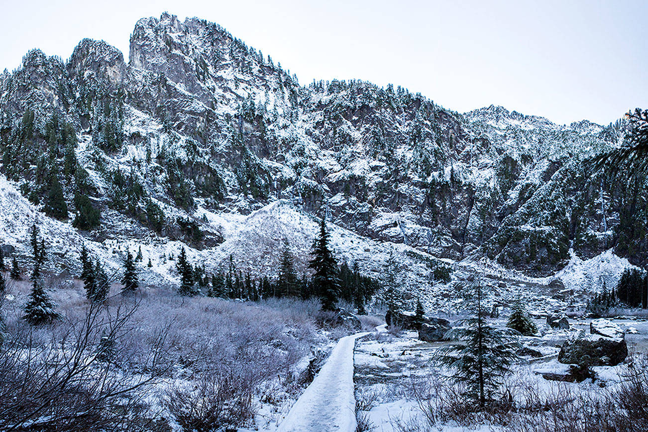 An elevated walking path that runs along Heather Lake is covered with snow on Wednesday, Dec. 5, 2018 in Granite Falls, Wa. (Olivia Vanni / The Herald)