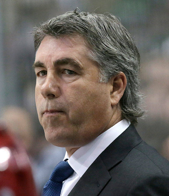 In this March 31, 2016 photo, Arizona Coyotes head coach Dave Tippett looks on from the bench during the first period of an NHL game against the Dallas Stars. Tippett will be in charge of building a hockey operations department for the new NHL expansion team in Seattle. (AP Photo/LM Otero, file)