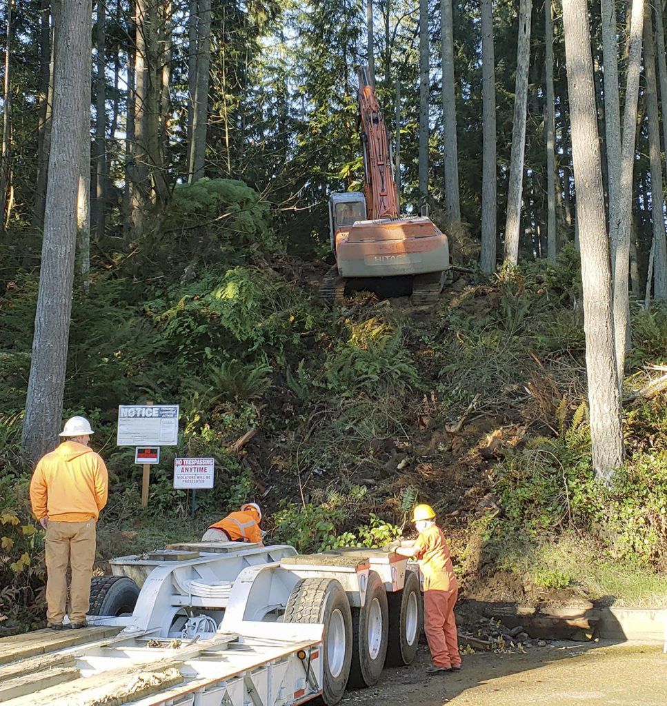 Workers begin clearing Wednesday for the Frognal Estates development near Picnic Point. Crews are preparing to build erosion-control fences required before more extensive logging can take place. (Noah Haglund / The Herald)
