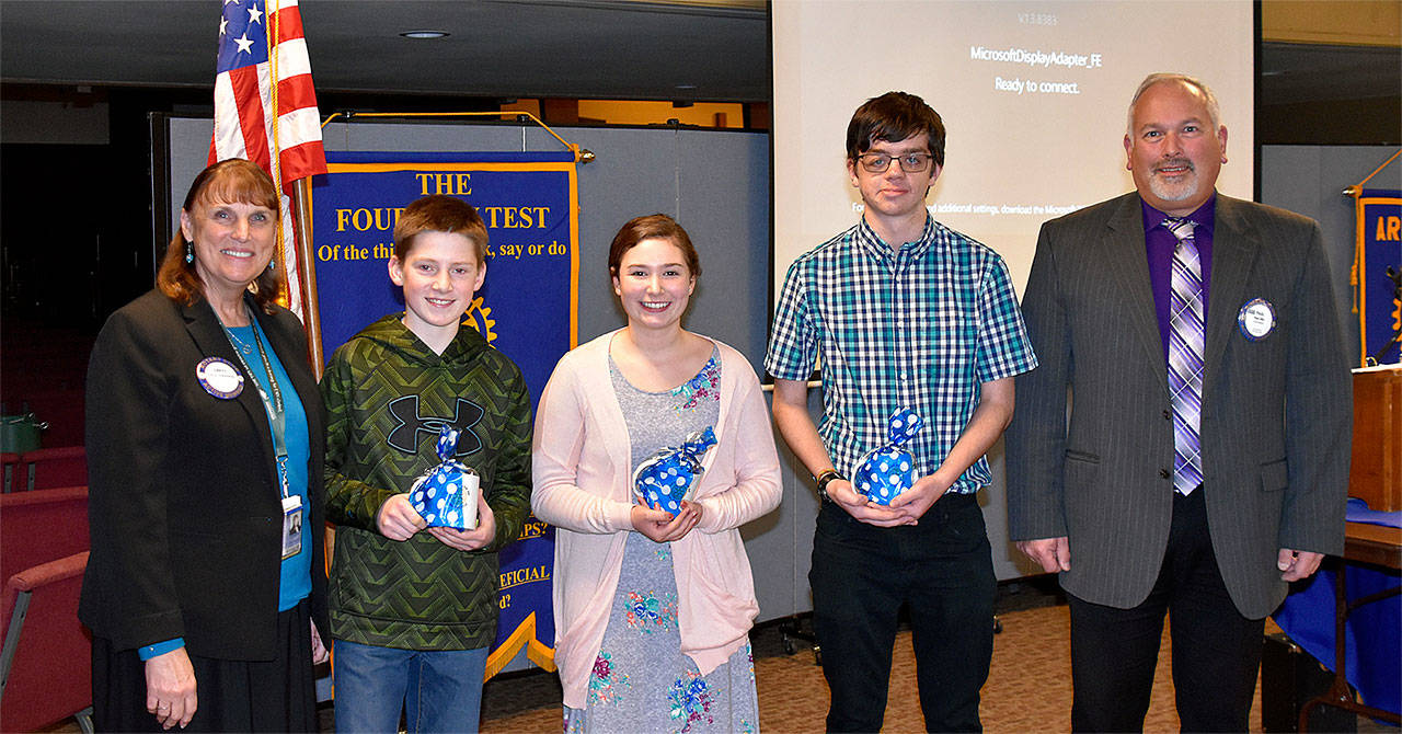 Arlington students were recognized Nov. 29 by the Rotary Club of Arlington for making a difference in their schools. Pictured from left are Arlington schools Superintendent Chrys Sweeting, Kaden Martinsen from Post Middle School, Trinity Bowles from Haller Middle School, Aaron Holocke from Weston High School, and Rotary President Paul Ellis. (Contributed photo)