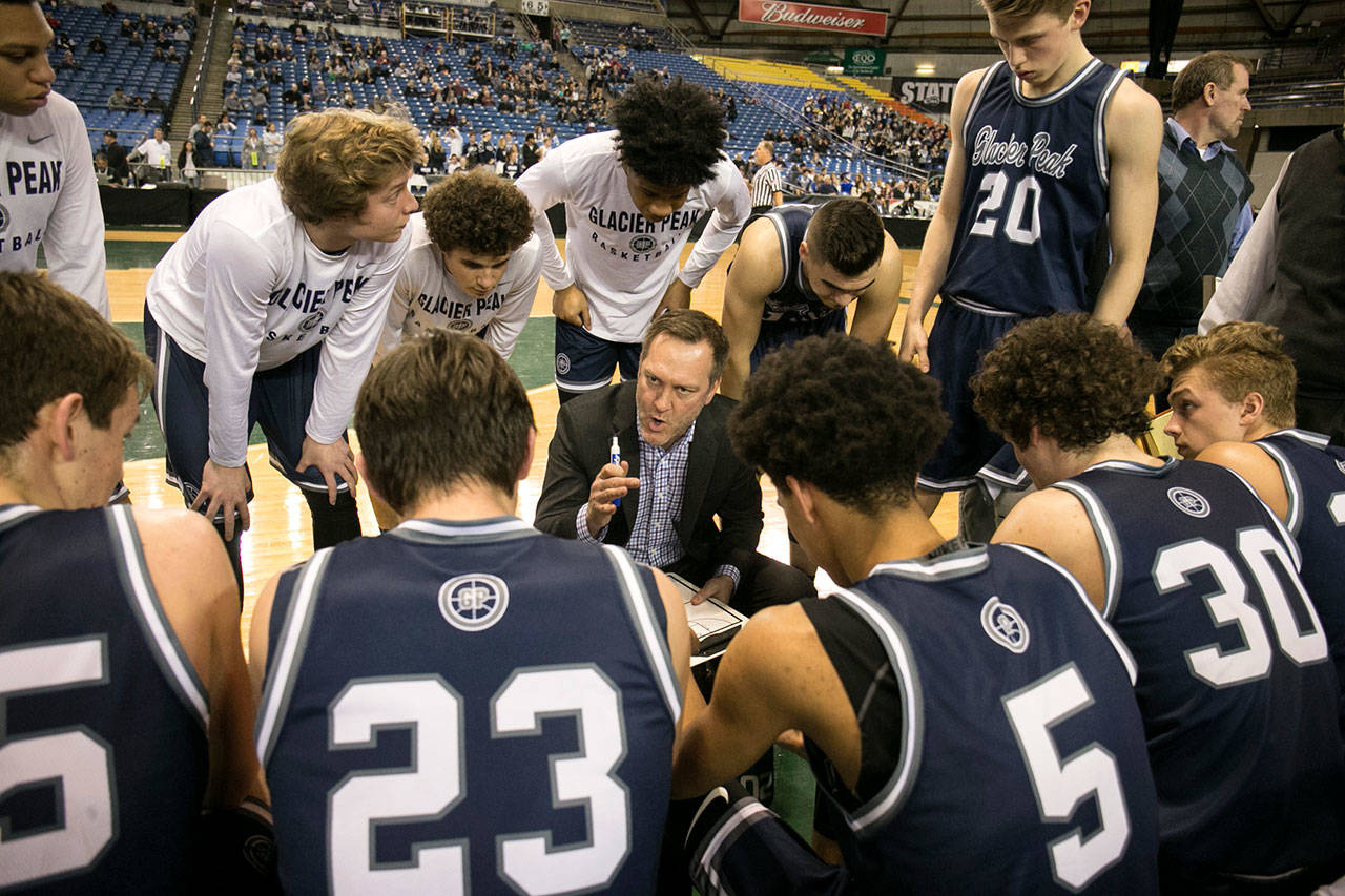 Glacier Peak head coach Brian Hunter gives his players instructions during a timeout in a Class 4A state basketball tournament game on Feb. 28 at the Tacoma Dome. The Grizzlies have won back-to-back Wesco 4A titles. (Kevin Clark / The Daily Herald)