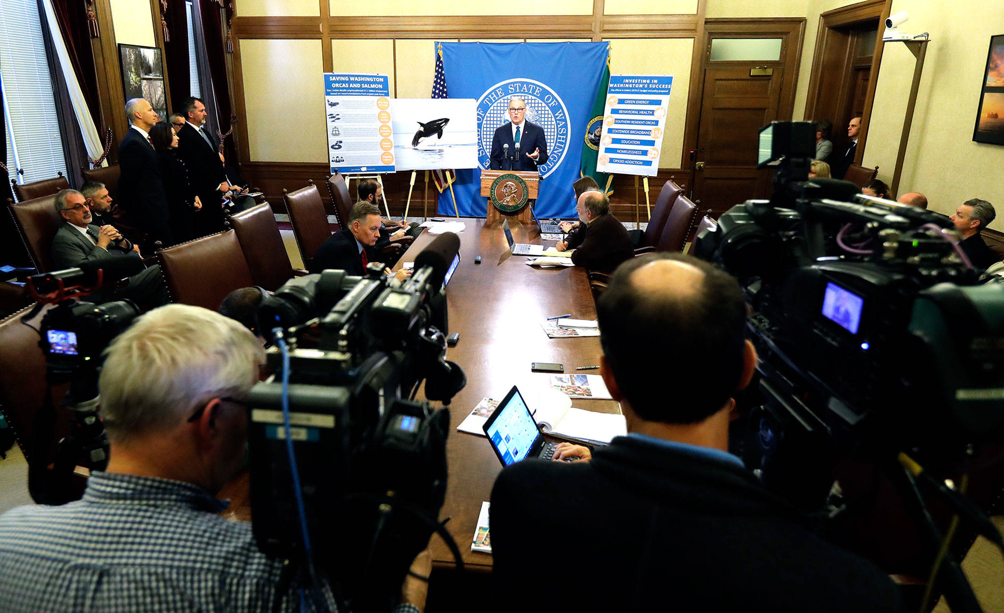 Washington Gov. Jay Inslee talks to reporters about his 2019-21 budget proposal on Thursday at the Capitol in Olympia. (AP Photo/Ted S. Warren)