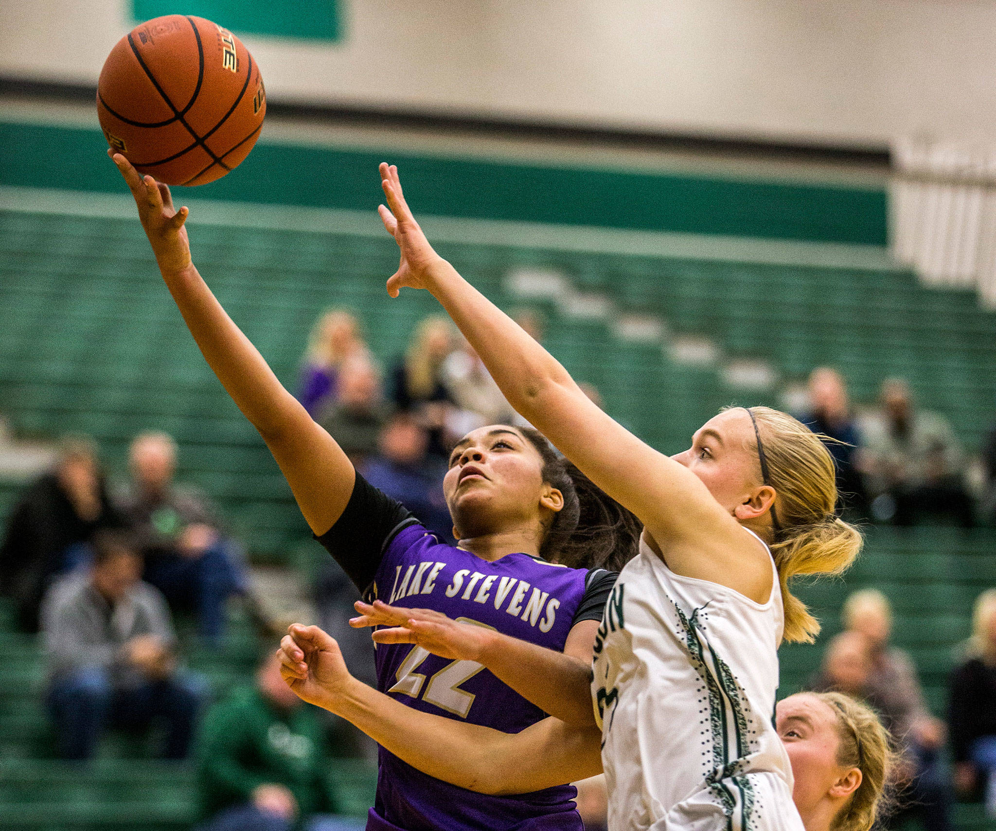 Lake Stevens' Raigan Reed attempts a layup during the game against Jackson on Dec. 11 in Everett. (Olivia Vanni / The Herald)