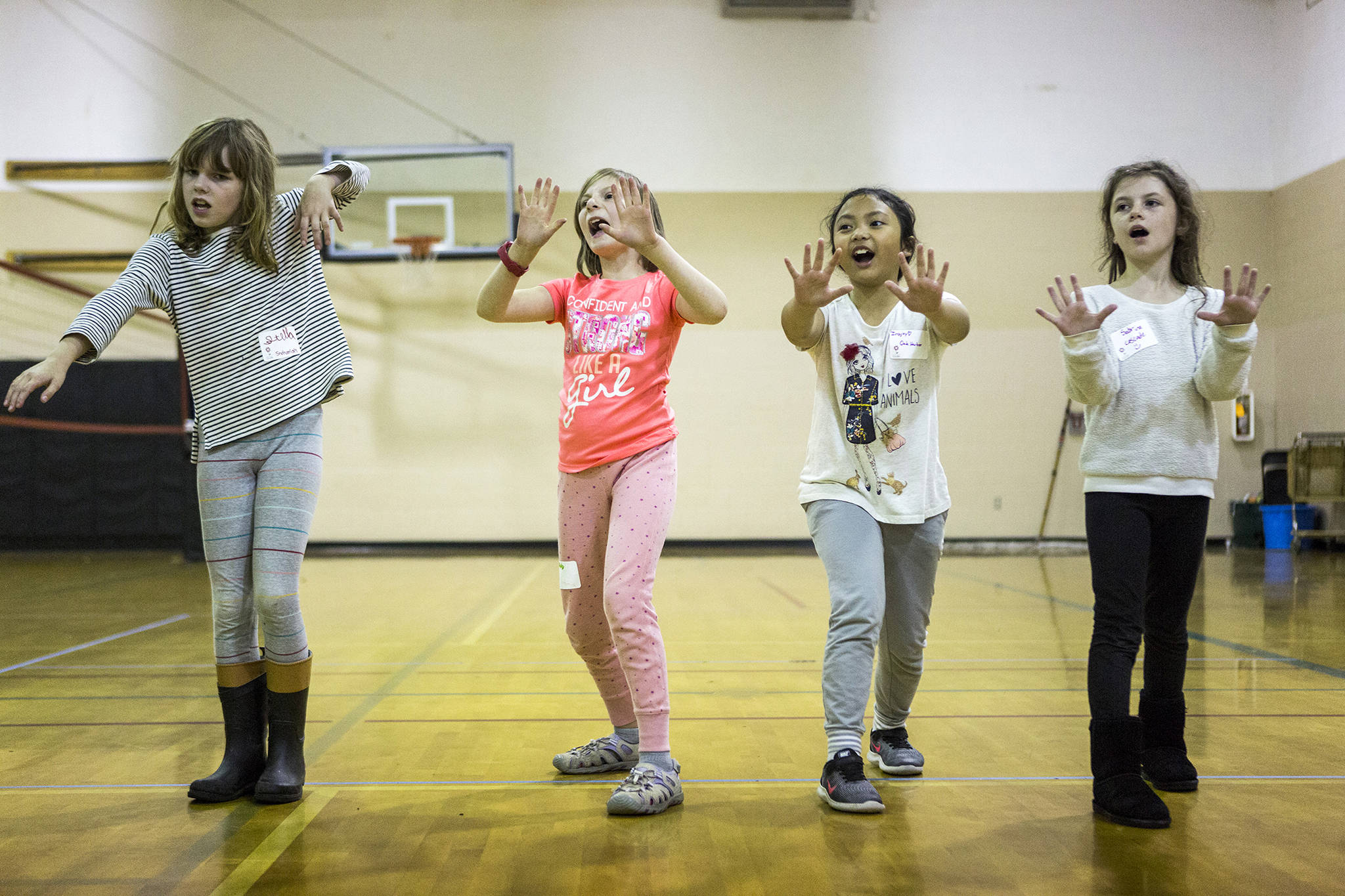 """From left, Stella McClung, 9, Hailey Gaddis, 9, Irajoy Abrea, 9, and Sabrina Axtell, 9, play Sensei Says during the <a href=""""https://www.heraldnet.com/news/inspireher-shows-girls-how-to-achieve-and-build-up-steam/"""" target=""""_blank"""">InspireHER event</a> at Snohomish Boys & Girls Club on Nov. 2 in Snohomish. (Olivia Vanni / The Herald)"""