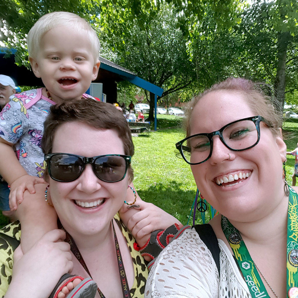 Miriam Robinson (left) died in a head-on crash July 1 on I-5 near Arlington. Her friend Dora-Jean Wyne (right) survived the crash by swerving her car. Wyne and her 1½-year-old son (shown here on Robinson's shoulders) suffered minor injuries. (Family photo)