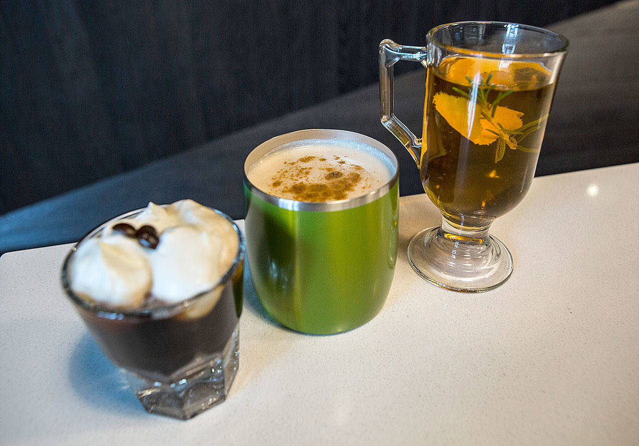 From left, a coffee bourbon warmer, a vanilla vodka chai and an autumnal cider toddy at Scratch Distillery. (Olivia Vanni / The Herald)