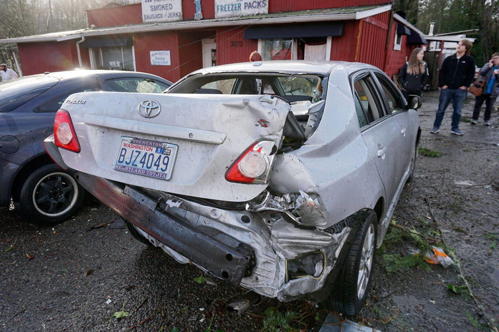 An unidentified woman driving on Bethel Avenue had her vehicle lifted up and smashed to the pavement by a tornado that crossed the roadway just after 2 p.m. in Port Orchard. The woman was slightly injured. (Bob Smith / Kitsap Daily News)