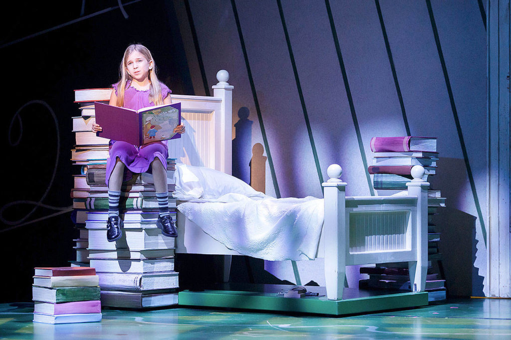 """Nava Ruthfield stars as Matilda in Village Theatre's production of """"Matilda the Musical,"""" which opens Jan. 4 in Everett. The title role is shared by Holly Reichert and Nava Ruthfield in alternate performances. (Mark Kitaoka/Village Theatre)"""