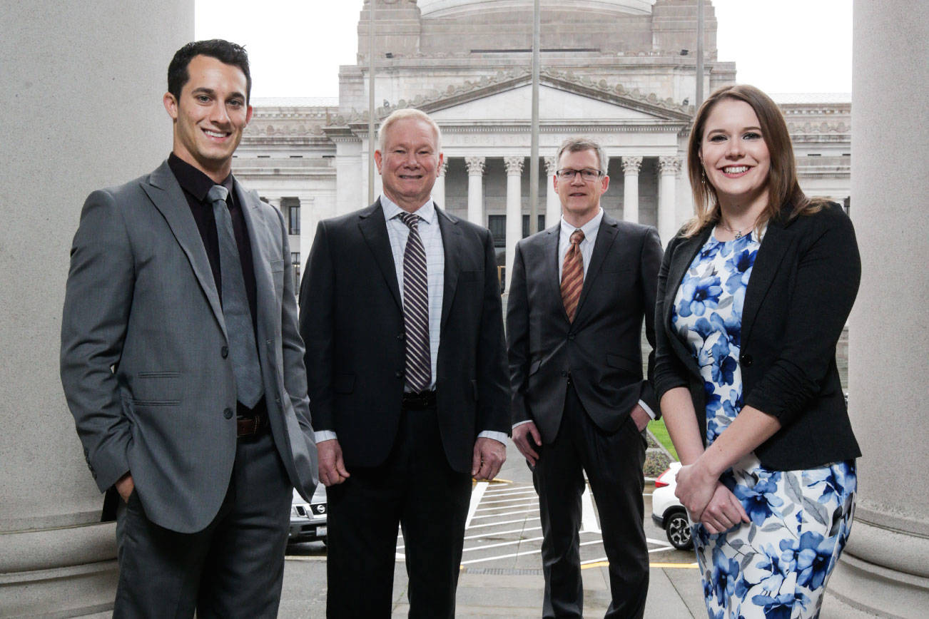 Snohomish County's newest representatives gather outside the Capitol during a break in orientation activities ahead of Monday's start of the 2019 session. Pictured are Democrat Jared Mead (from left), of Mill Creek, Republican Robert Sutherland, of Granite Falls, Democrat Dave Paul, of Oak Harbor, and Democrat Lauren Davis, of Shoreline. (Andy Bronson / The Herald)