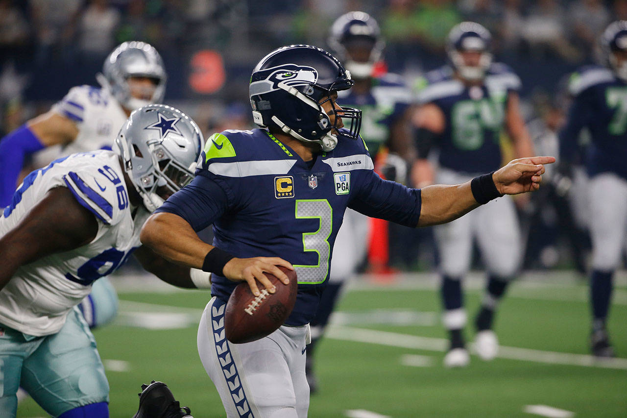 Seahawks quarterback Russell Wilson (3) runs out of the pocket during a playoff game against the Cowboys on Jan. 5, 2019, in Arlington, Texas. (AP Photo/Ron Jenkins)