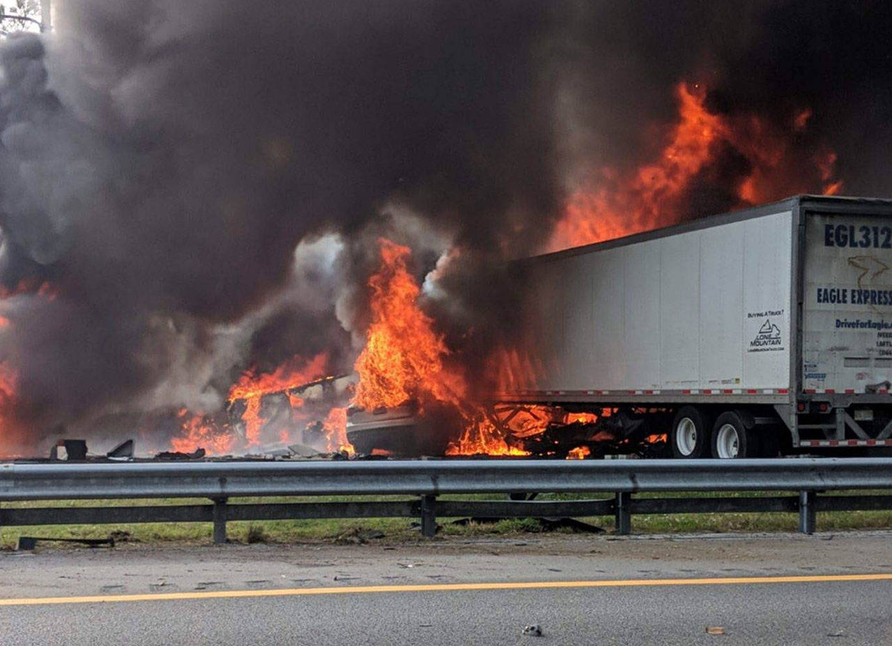 Flames engulf vehicles after a fiery crash along Interstate 75 on Jan. 3 near Gainesville, Florida. A church van packed with children was headed to Walt Disney World when it got caught in a fiery pileup involving two 18-wheelers. Seven people, including five of the children, died in the crash. (WGFL-Gainesville via AP, file)