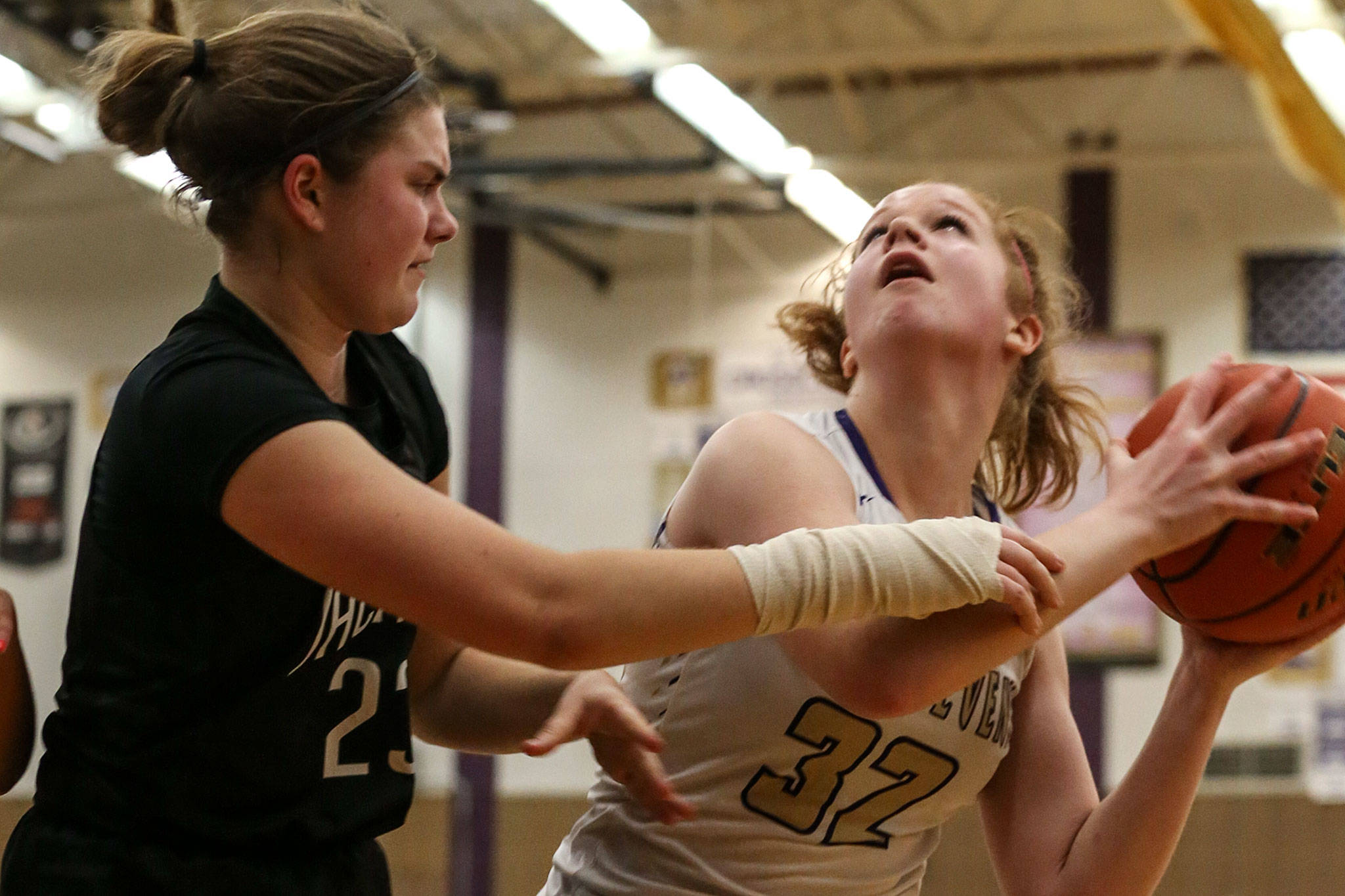 Lake Stevens' Cori Wilcox (right) looks to score with Jackson's Olivia Skibiel defending during the Vikings' 62-39 win Tuesday night at Lake Stevens High School. (Kevin Clark / The Herald)