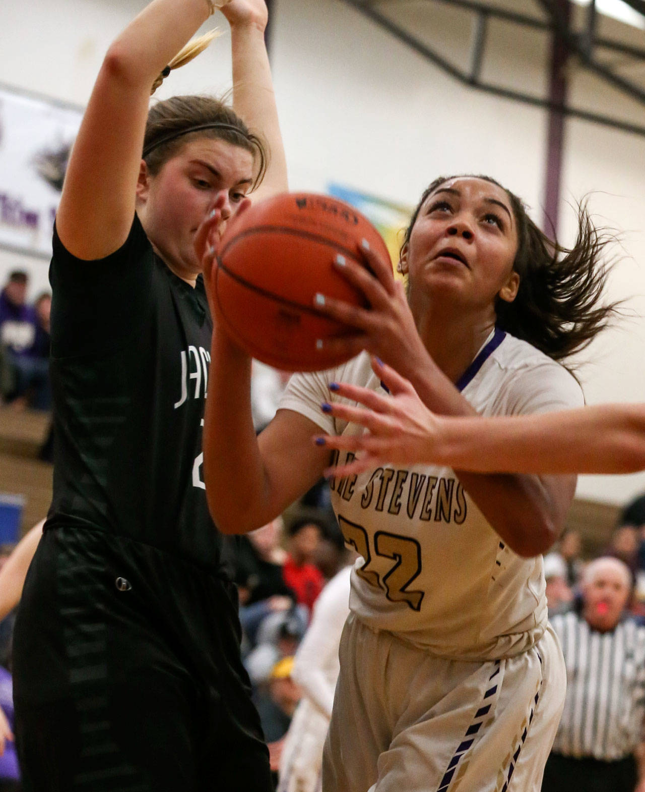 Lake Stevens' Raigan Reed (right) look to score with Jackson's Olivia Skibiel defending during the Vikings' 62-39 win Tuesday night at Lake Stevens High School. (Kevin Clark / The Herald)