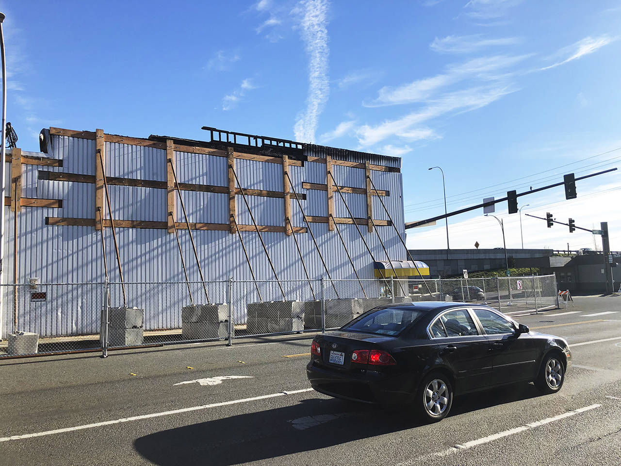 Almost four months after a fire at Judd & Black in Everett, police announced it was caused by arson. One lane of northbound Maple Street was still closed Wednesday at Hewitt Avenue. (Caleb Hutton / The Herald)