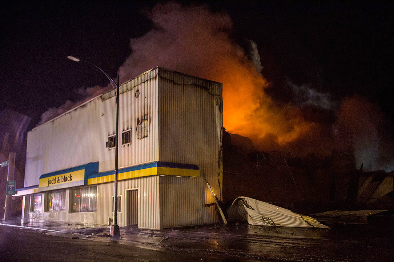 The Judd & Black appliance store burns on Sept. 21, 2018, in Everett. (Olivia Vanni / Herald file)