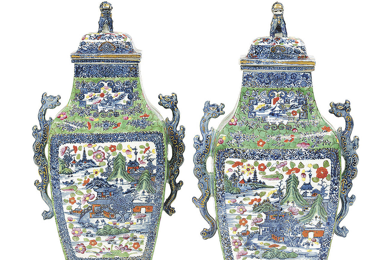 A pair of Chinese urns from the mid-1800s were painted over