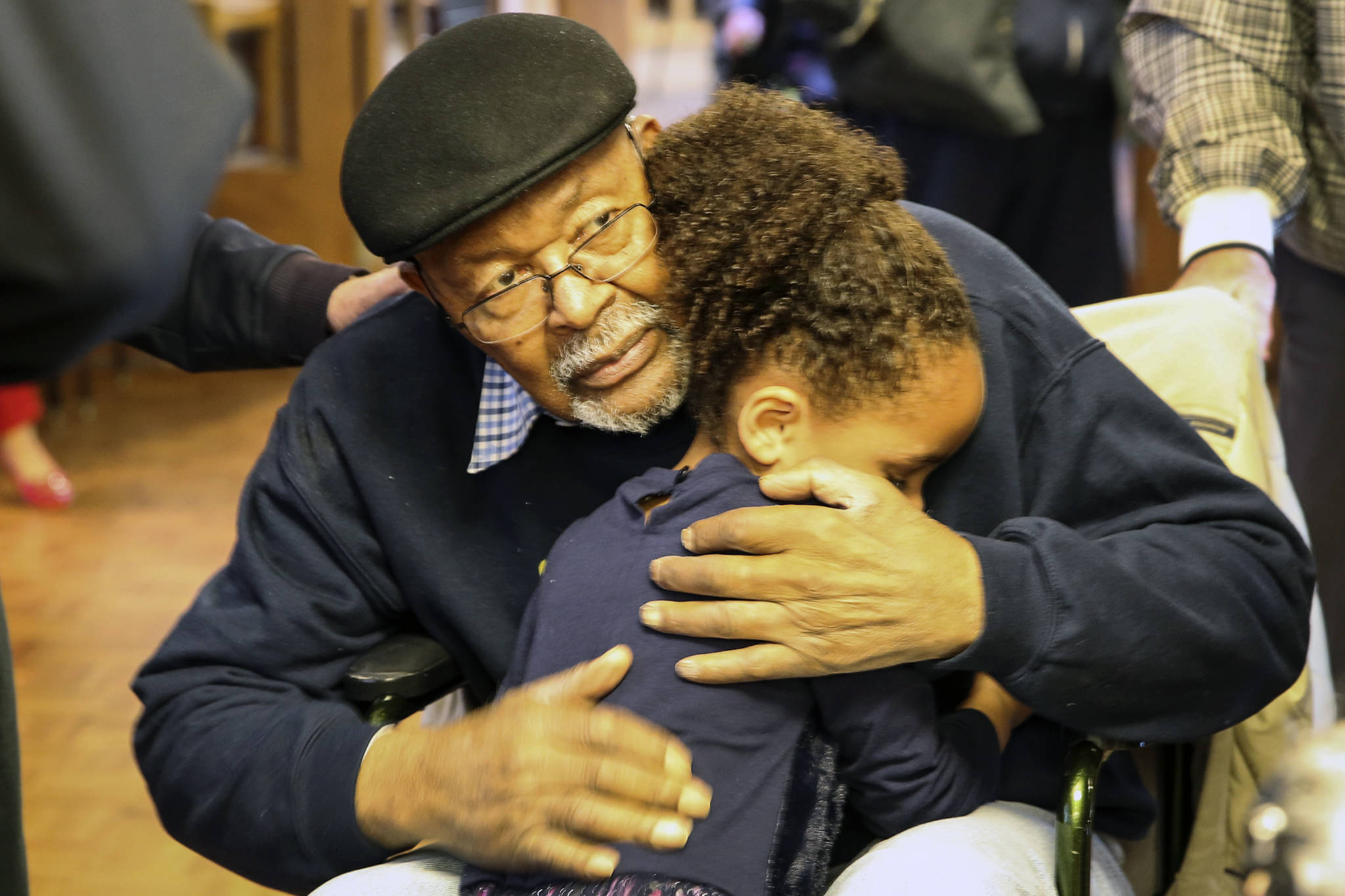 Carl Gipson gets a hug from his great-granddaughter, MyElli Richards, 4, during his birthday party at Carl Gipson Senior Center in Everett on Jan. 12, 2019. (Kevin Clark / The Herald)