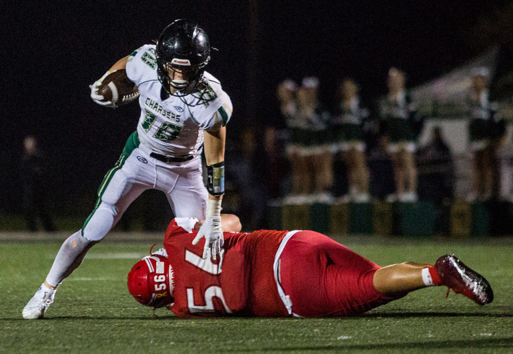 Marysville Getchell running back Ryan King (top) is tackled by Marysville Pilchuck's Lincoln Davis during a game on Oct. 5, 2018, in Marysville. (Olivia Vanni / The Herald)