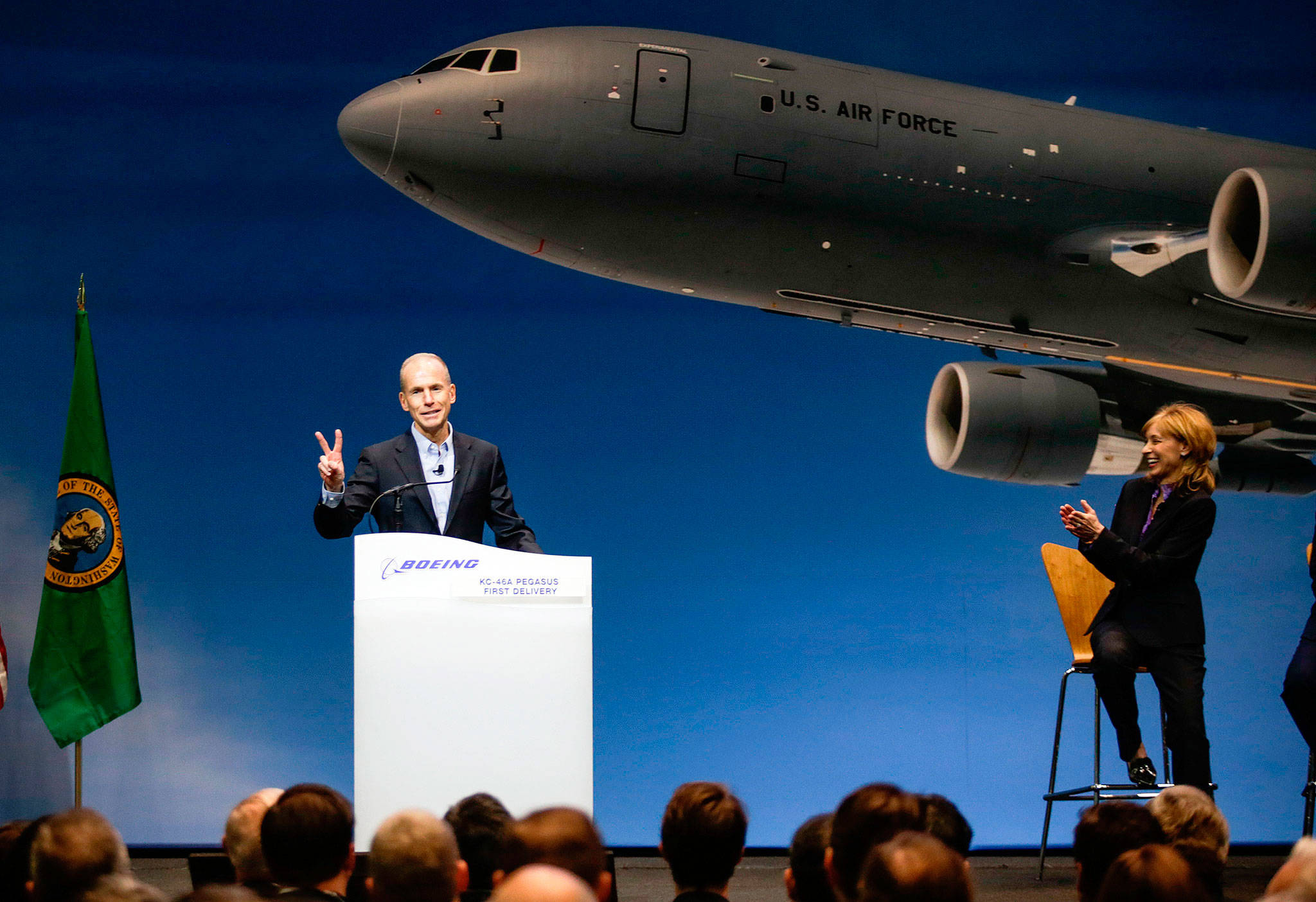 Company Chairman, President and CEO Dennis Muilenburg (left) gets a laugh on Thursday at the Boeing factory at Paine Field in Everett as he points out that two KC-46 Pegasus planes would be delivered to the U.S. Air Force. (Andy Bronson / The Herald)