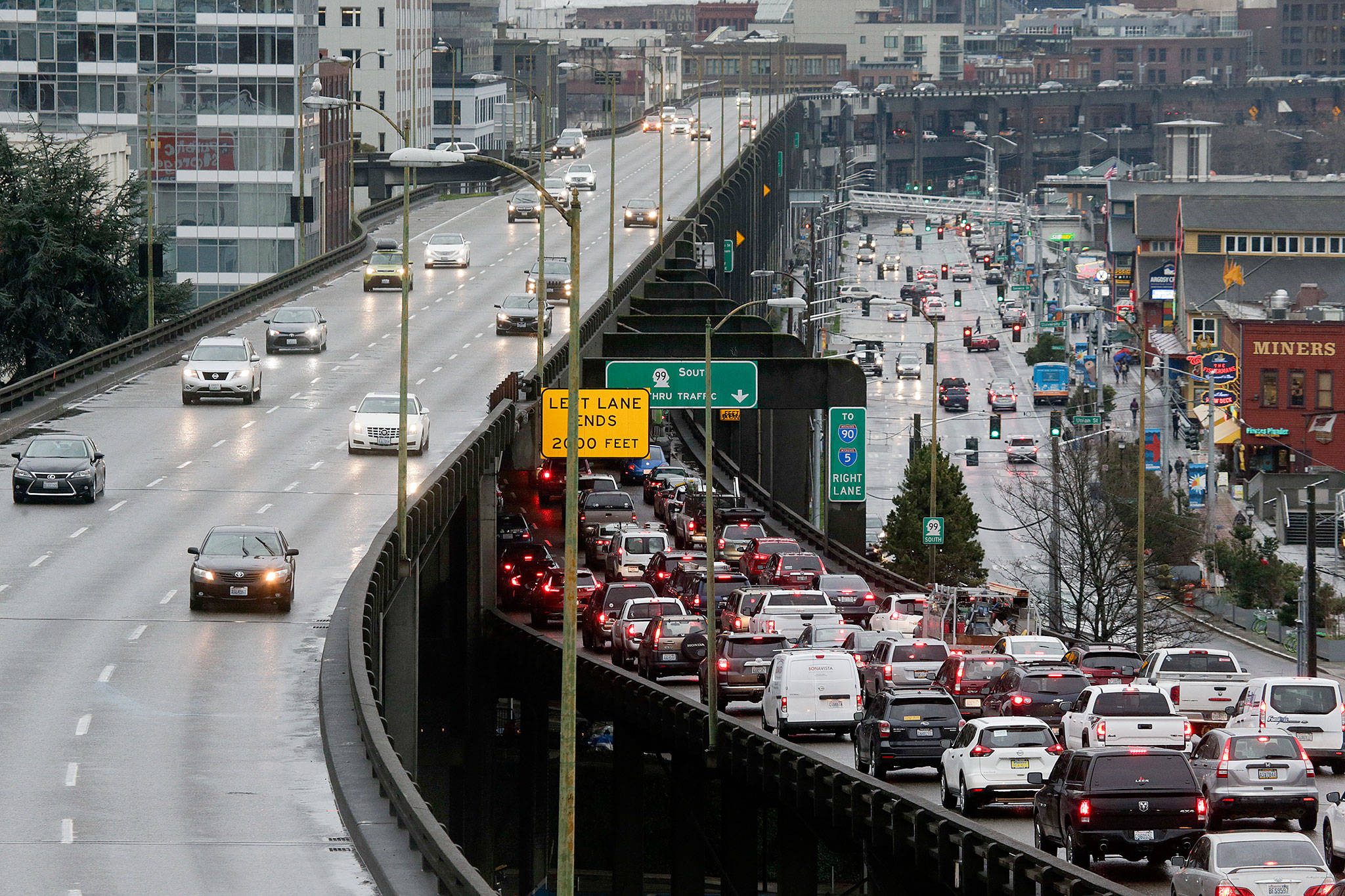 Southbound traffic backs up as northbound drivers cruise on with ease on the State Route 99 viaduct three days before its closure. (Andy Bronson / Herald file)