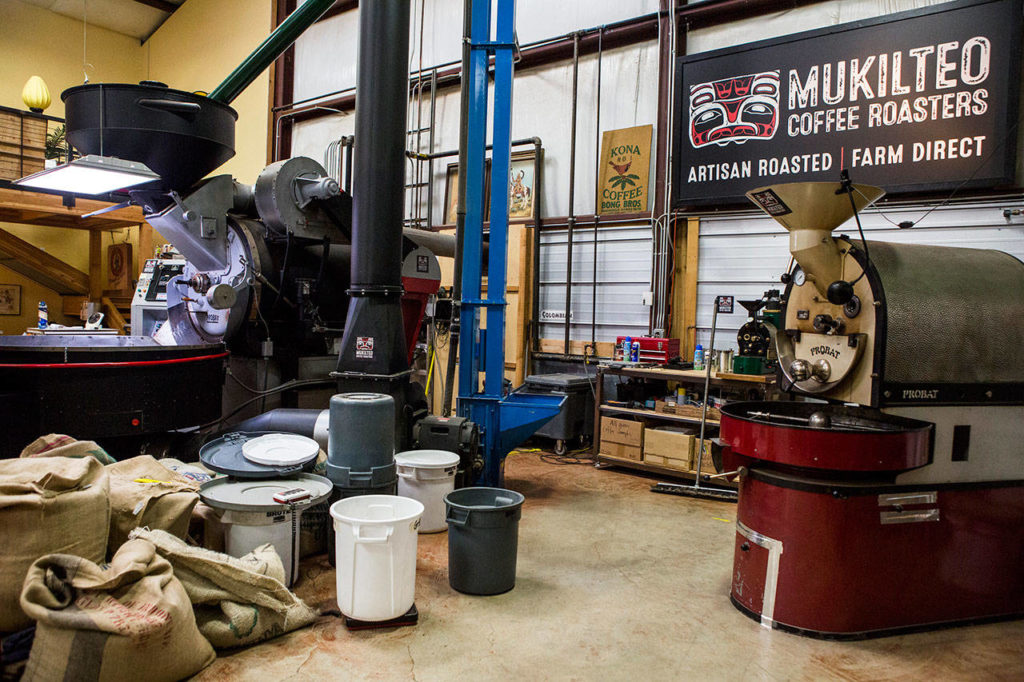 Two large industrial coffee roasters sit in one of two roastery buildings Oct. 10, 2018, at Mukilteo Coffee Roasters in Langley. (Olivia Vanni / The Herald)