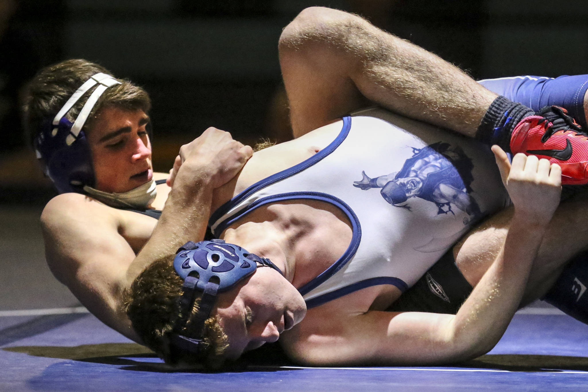 Granite Falls' Hayden Long (left) works to pin Sultan's Michael Moss at Sultan High School on Jan. 24. (Kevin Clark / The Herald)