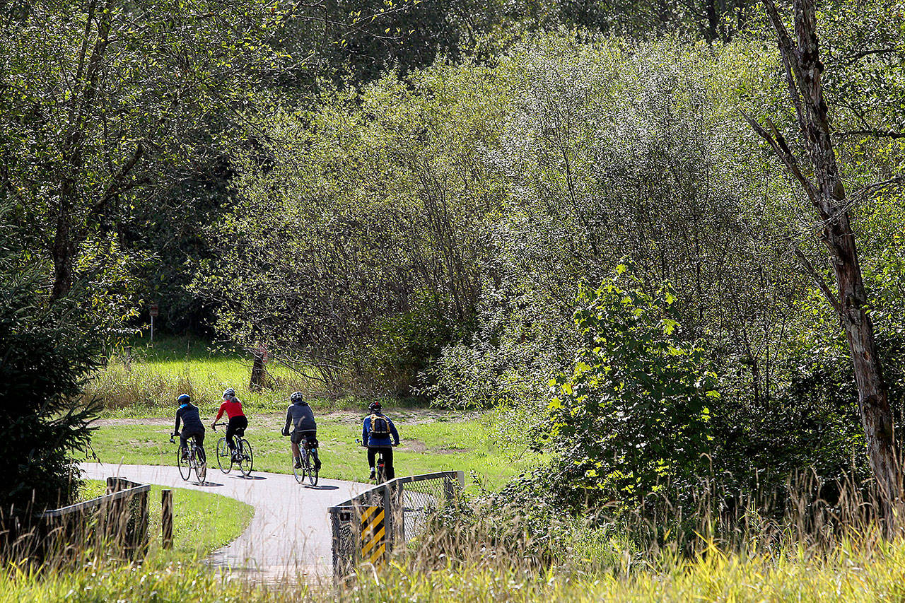 Cyclists ride along the Centennial Trail in September, 2015, near the Nakashima Barn, north of Arlington. The Centennial Trail and the Nakashima Barn have received state grant funding through the Washington Wildlife and Recreation Program. (Genna Martin/Herald file photo)
