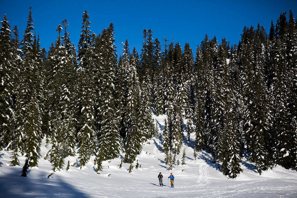 Two snowshoers make their way across Skyline Lake on Saturday, Jan. 26, 2019 in Leavenworth, Wa. (Olivia Vanni / The Herald)
