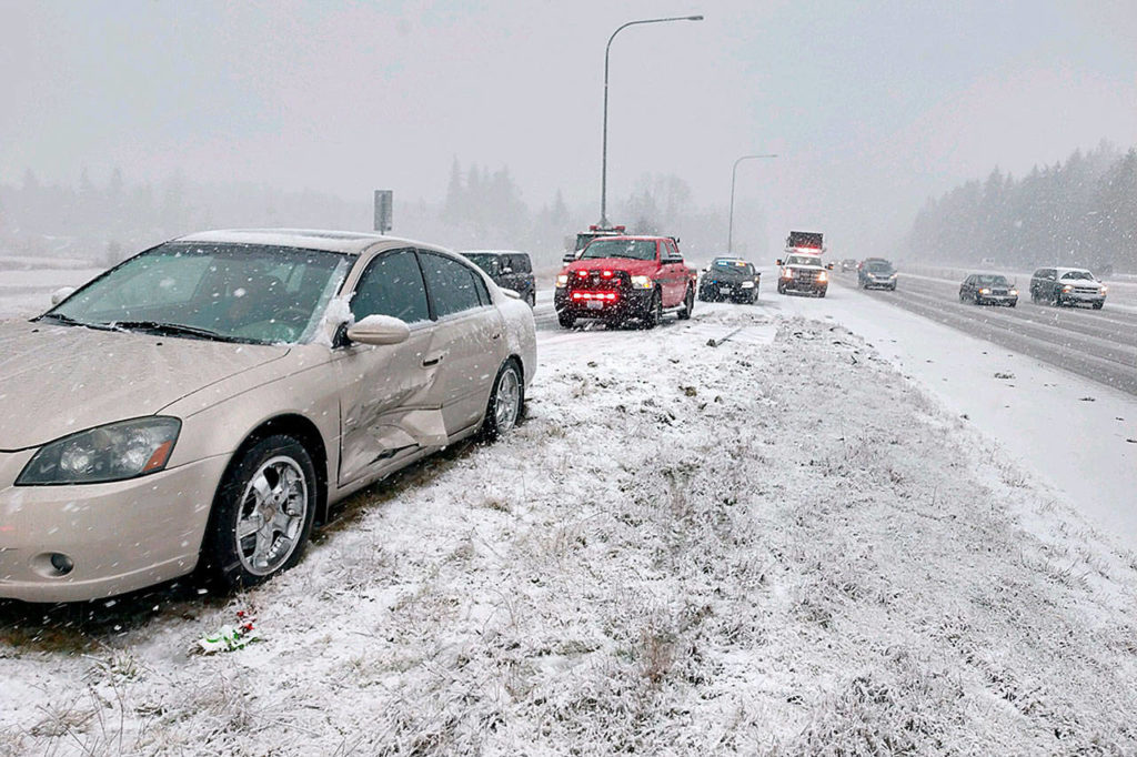 Several cars lost control and spun off the roadway during a snowstorm Sunday. The Washington State Patrol reported that there were no serious injuries in the vehicles seen here between emergency response vehicles near Stanwood. (Washington State Patrol)