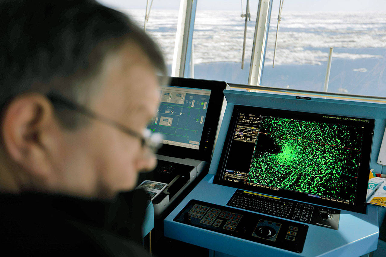 A radar shows sea ice ahead of the Finnish icebreaker MSV Nordica as chief officer Harri Venalainen navigates the ship through the Beaufort Sea while traversing the Arctic's Northwest Passage on July 16, 2017. The magnetic north pole is wandering about 34 miles a year. At the end of 2017 it crossed the international date line. That means it's not even the same day at the new magnetic north pole as it is at the spot of 2010's magnetic north pole. It's leaving the Canadian Arctic on its way to Siberia. (AP Photo/David Goldman, File)
