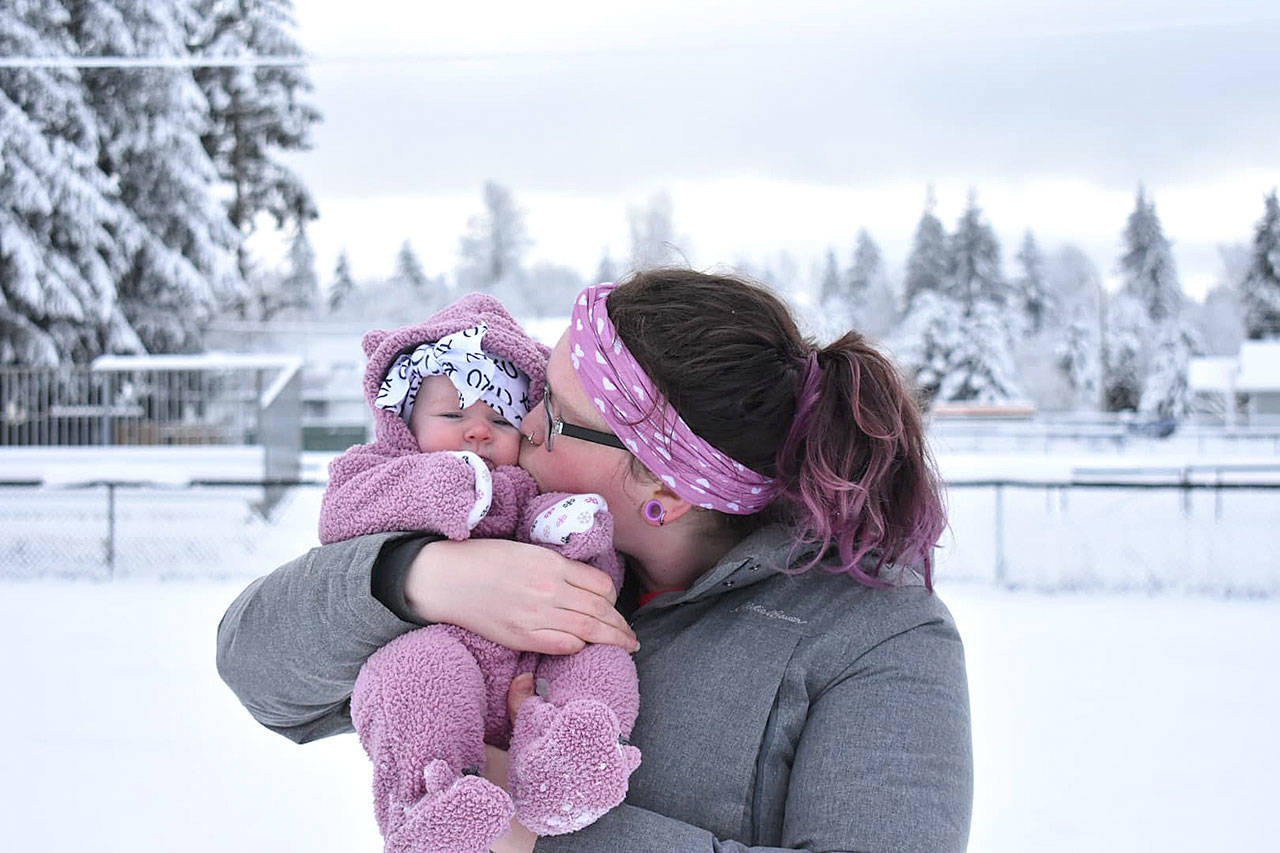 Mother and daughter Madison and Raelin Franchi are in matching purple for baby's first snow in Granite Falls. Raelin is just 3 months old. (Susan Fraley)