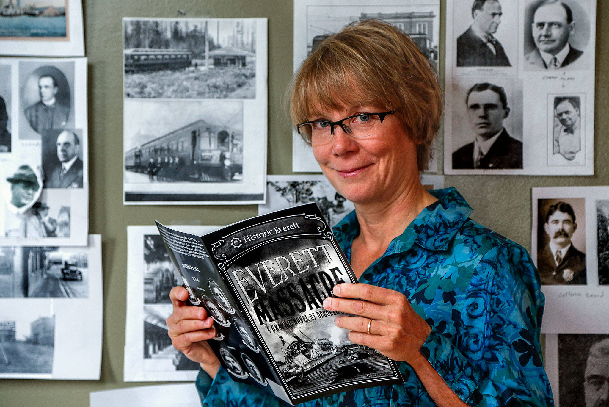 Inside Deb Fox's finished graphic novel, lying atop a storyboard-sketchbook in the artist's home studio, shadowy charcoal characters come alive with words, sprouting circles of dialogue from a 100-year-old conflict. (Dan Bates / The Herald)
