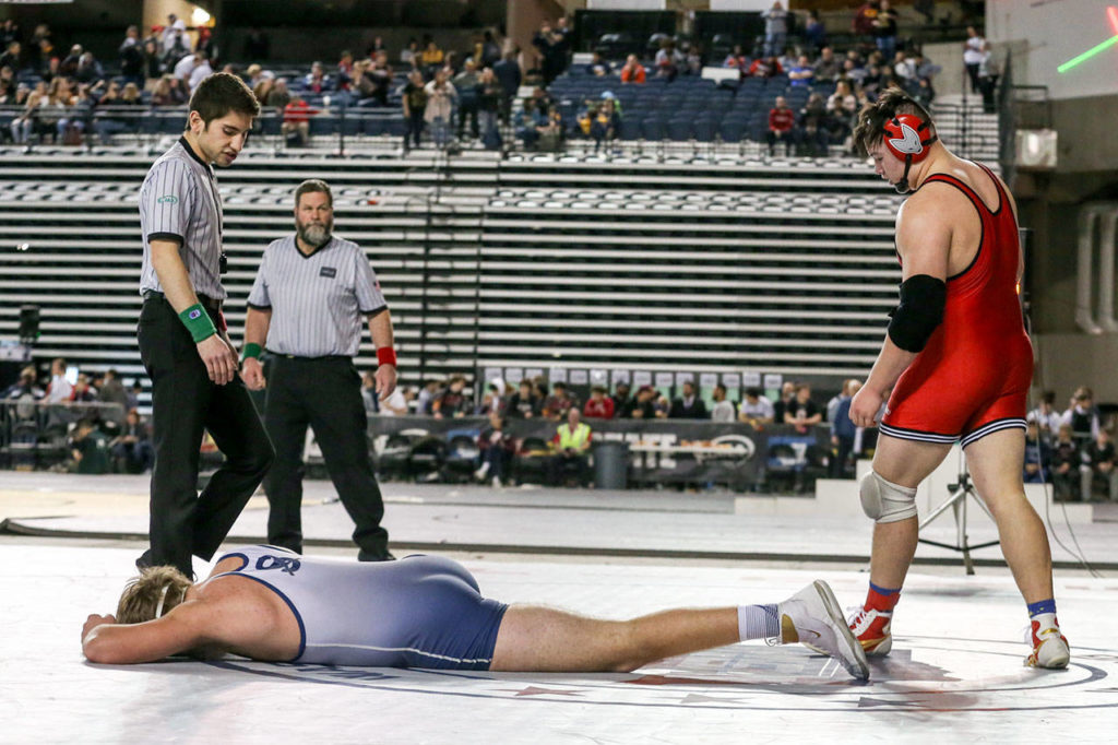 Sultan's Tyler Deason is left dejected after falling to Granger's Gage Cook in the 220 weight class Saturday night during the Mat Classic XXXI at the Tacoma Dome on February 15, 2019 in Tacoma. Deason finished second in state. (Kevin Clark / The Herald)