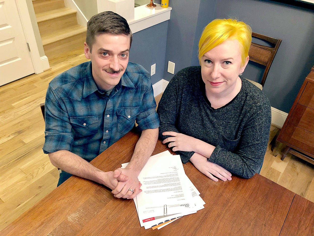 Husband and wife Andy Kraft and Amy Elias, of Portland, Oregon, with their 2018 tax paperwork. (AP Photo/Gillian Flaccus)