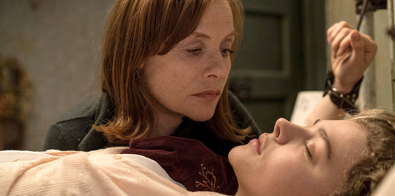 "Isabelle Huppert (left) has something sinister in mind for Chloe Grace Moretz in ""Greta."" (Focus Features)"