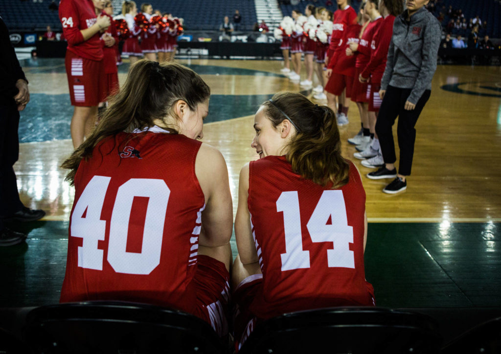Snohomish's Courtney Perry and Snohomish's Maya DuChesne wait for their names to be called before the start of the game against Seattle Prep at the 3A Girls Hardwood Classic on Wednesday, Feb. 27, 2019 in Tacoma, Wash. (Olivia Vanni / The Herald)